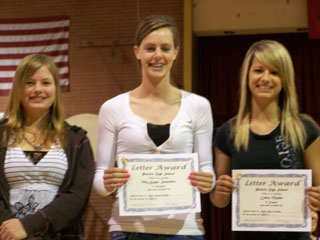 makayla schaeffer and callie mader received their letter awards for rodeo at the